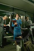 female executive, airport phone