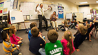"LRCC President Dr. Scott Kalicki reads ""Frankie Stein"" to the students in Miss Faria's and Mrs. Olson's first grade classes at Pleasant Street School Thursday afternoon.  (Karen Bobotas/for the Laconia Daily Sun)"