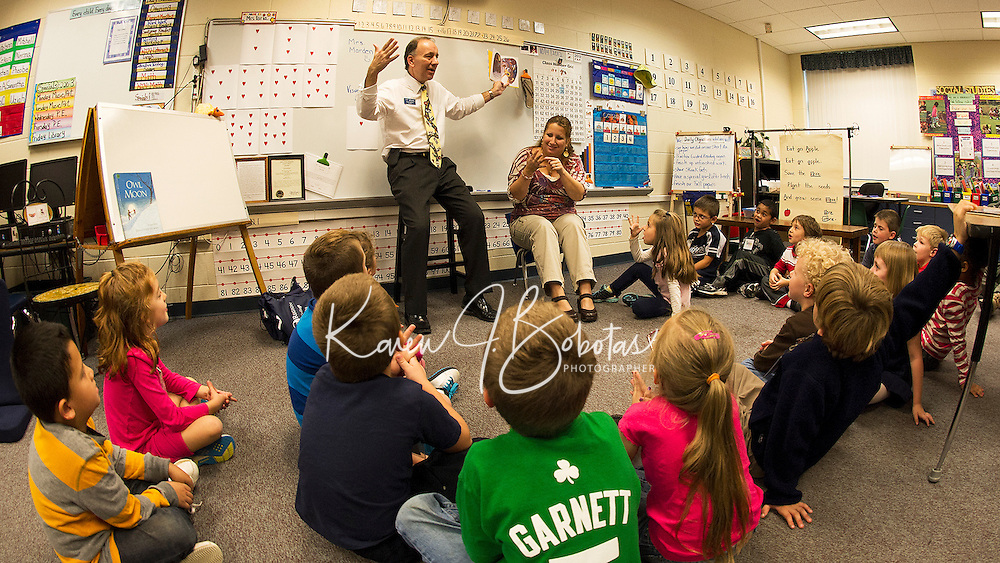 """LRCC President Dr. Scott Kalicki reads """"Frankie Stein"""" to the students in Miss Faria's and Mrs. Olson's first grade classes at Pleasant Street School Thursday afternoon.  (Karen Bobotas/for the Laconia Daily Sun)"""