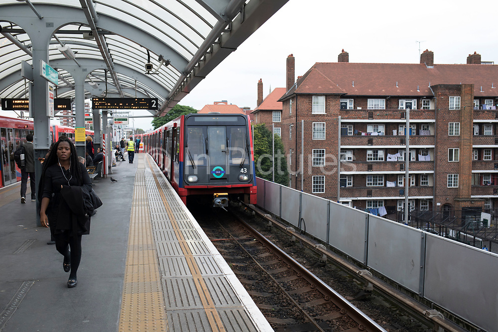 DLR train pulling in to Limehouse station in the East End, London, UK. The Docklands Light Railway is an automated light metro system opened in 1987 to serve the redeveloped Docklands area of London.