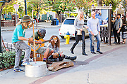 Street musicians busk in front of Pritchard Park in Asheville, North Carolina.