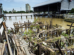 August 16, 2017 - Bangkok, Bangkok, Thailand - All that is left of some of the homes after city officials tore down several homes built on pilings in the Wat Thewarat Kunchorn community along the Chao Phraya River in Bangkok. City officials are evicting people who live in small homes along the riverfront so they can build a 14km long promenade. Their plans call for removal of 273 homes in 14 riverside communities. The people who live in the homes are among the most impoverished in Bangkok. (Credit Image: © Sean Edison via ZUMA Wire)