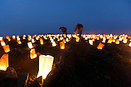 Close up of volunteers lighting luminaries at the Lands End Labyrinth - San Francisco, California