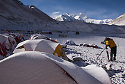 China, Tibet, view of Everest (Chomolongma - 29,029 ft. or 8848 m), UEverest 1st camera man, Ken Sauls, morning sun, snow dusted on tents