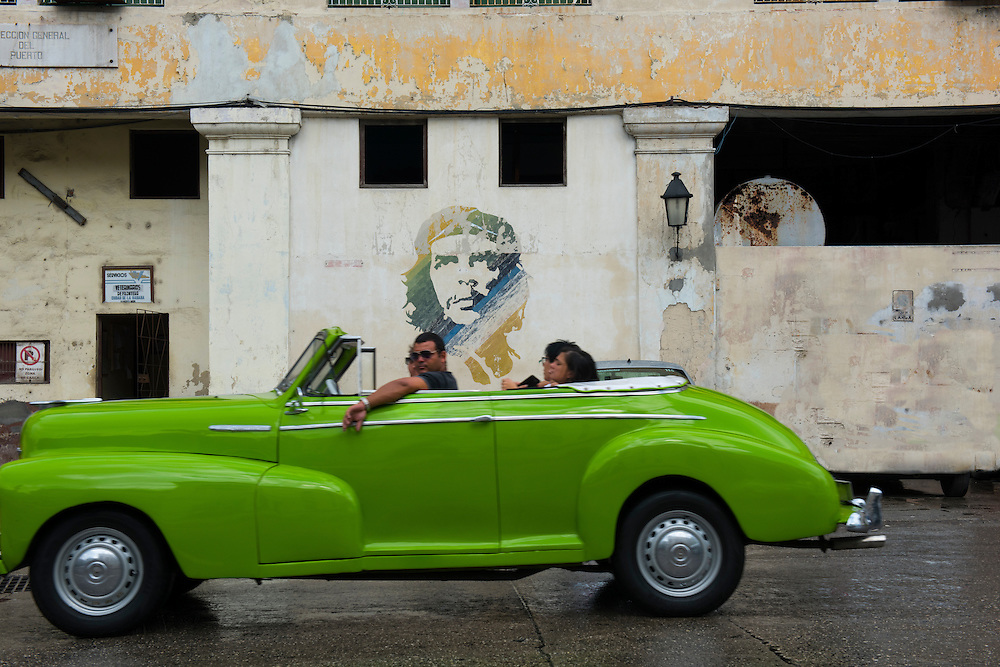 Havana, Cuba - October 2015: Old classic American cars roam the streets of Havana. The US embargo and the local restrictions on car purchases give Cuban few alternatives but to keep the vintage cars running.