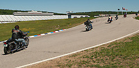 Motorcyclists came out to support the Boys and Girls Club of the Lakes Region and take a spin around the oval during the Community Appreciation Parade at NHMS on Saturday morning.  (Karen Bobotas/for the Laconia Daily Sun)