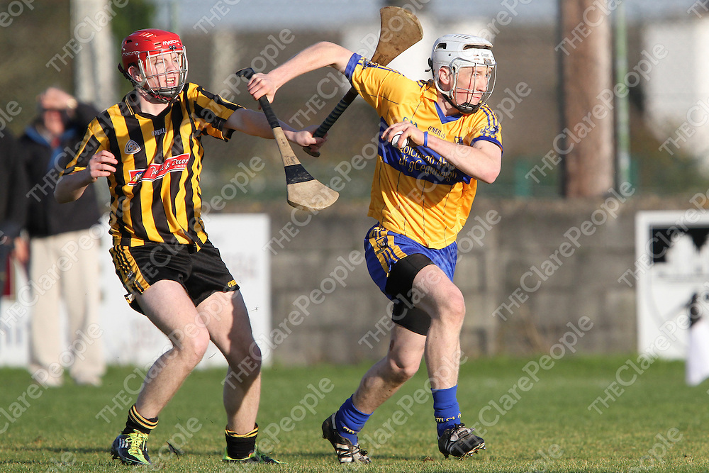Eoin Hogan Sixmilebridge comes away with possession as Ballyea's Alan Dalton attempts to get in a hook.<br /> Photograph by Flann Howard