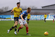 Carlisle United defender Danny Grainger holds up ]Oxford United midfielder Callum O'Dowda during the Sky Bet League 2 match between Oxford United and Carlisle United at the Kassam Stadium, Oxford, England on 12 December 2015. Photo by Alan Franklin.