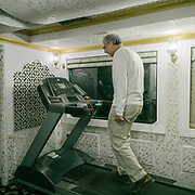 A guest at the gym in  the Palace on Wheels, a vintage luxury train crossing Rajahstan province.