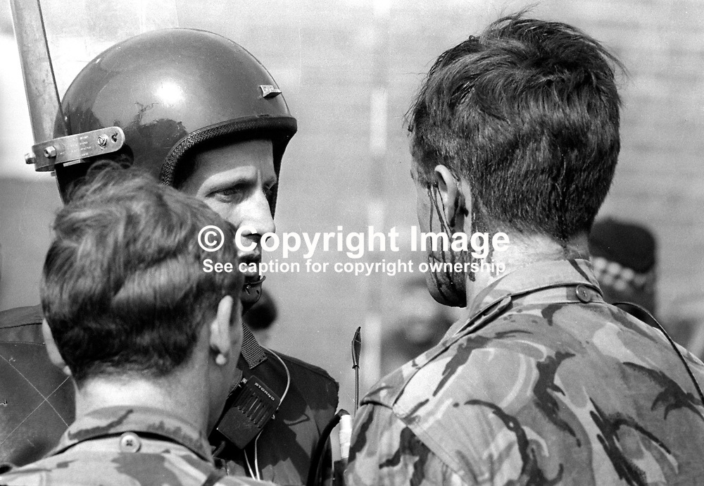 The Silver Jubilee visit of Queen Elizabeth II to N Ireland on 10th & 11th August 1977 sparked serious rioting in Belfast as those opposed to the visit tried to reach the city centre.  Here an injured soldier is comforted by colleagues. 197708100074c<br /> <br /> Copyright Image from Victor Patterson, Belfast, UK<br /> <br /> t: +44 28 9066 1296 (from Rep of Ireland 048 9066 1296)<br /> m: +44 7802 353836<br /> e: victorpattersonbelfast@gmail.com<br /> <br /> www.images4media.com<br /> <br /> Please see my full Terms and Conditions of Use at https://www.images4media.com/p/terms-conditions - it is IMPORTANT that you familiarise yourself with them.<br /> <br /> Images used online incur an additional cost. This cost should be agreed in writing in advance. Online images must be visibly watermarked i.e. © Victor Patterson or that of the named photographer within the body of the image. The original metadata must not be deleted from images used online.<br /> <br /> This image is only available for the use of the download recipient i.e. television station, newspaper, magazine, book publisher, etc, and must not be passed on to a third party. It is also downloaded on condition that each and every usage is notified within 7 days to victorpattersonbelfast@gmail.com.<br /> <br /> The right of Victor Patterson (or the named photographer) to be identified as the author is asserted in accordance with The Copyright Designs And Patents Act (1988). All moral rights are asserted.