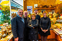 Employees of the Fromagerie (cheese shop) Marie-Anne Cantin on rue Champ de Mars in the Rue Cler market, Paris, France.
