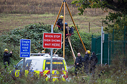 West Hyde, UK. 9th September, 2020. Hertfordshire Police officers remove an anti-HS2 activist from a tripod used to block one of several entrances to the Chiltern Tunnel South Portal site for the HS2 high-speed rail link for the entire day. The protest action, at the site from which HS2 Ltd intends to drill a 10-mile tunnel through the Chilterns, was intended to remind Prime Minister Boris Johnson that he committed to remove deforestation from supply chains and to provide legal protection for 30% of UK land for biodiversity by 2030 at the first UN Summit on Biodiversity on 30th September.