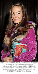 Social figure MISS TARA PALMER-TOMKINSON,  at a party in London on 27th February 2001.OLO  16