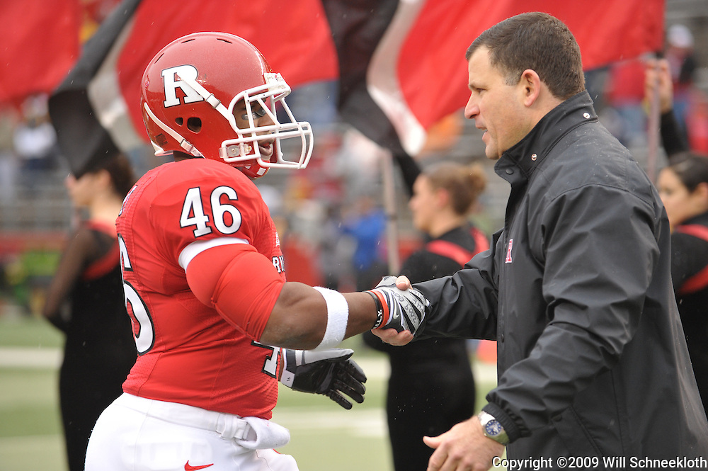 Dec 5, 2009; Piscataway, NJ, USA; Rutgers head coach Greg Schiano shakes hands with linebacker Stephant'E Kent during the senior ceremony before first half NCAA Big East college football action between Rutgers and West Virginia at Rutgers Stadium.