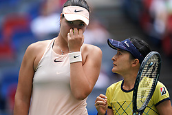 WUHAN, Sept. 28, 2018  Shuko Aoyama (R) of Japan and Lidziya Marozava of Belarus react during the doubles semifinal match against Elise Mertens of Belgium and Demi Schuurs of the Netherlands at the 2018 WTA Wuhan Open tennis tournament in Wuhan, central China's Hubei Province, on Sept. 28, 2018. Elise Mertens and Demi Schuurs won 2-1. (Credit Image: © Cheng Min/Xinhua via ZUMA Wire)