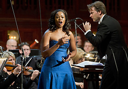 Jan. 27, 2014 - Prague, Czech Republic - Southafrican soprano Pretty Yende performs during a concert with Prague Philharmonia in Municipal House in Prague, Czech Republic, January 27, 2014. Pictured right is conductor Christopher Franklin. (Credit Image: © Vit Simanek/CTK/ZUMAPRESS.com)