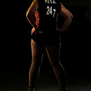 """Heather Martin, """"Pita"""",  from the Oc Roller Girls roller derby team poses for a portrait at the parking garage at the Crowne Plaza Hotel in Irvine Ca on Wednesday September 21, 2011."""