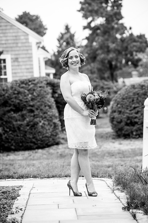A bride on her family house's pathway in Chatham, MA.