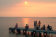 People watching sunset at La Albufera National Park, in Valencia, Spain.