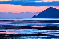 Pink sunrise and low tide create striped landscape near Kodiak, Alaska
