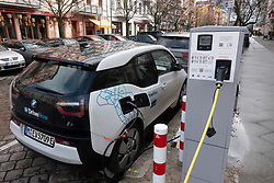 Electric car of Drive Now car sharing company  charging on street in Prenzlauer Berg, Berlin, Germany