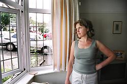 Woman gazing wistfully out of window