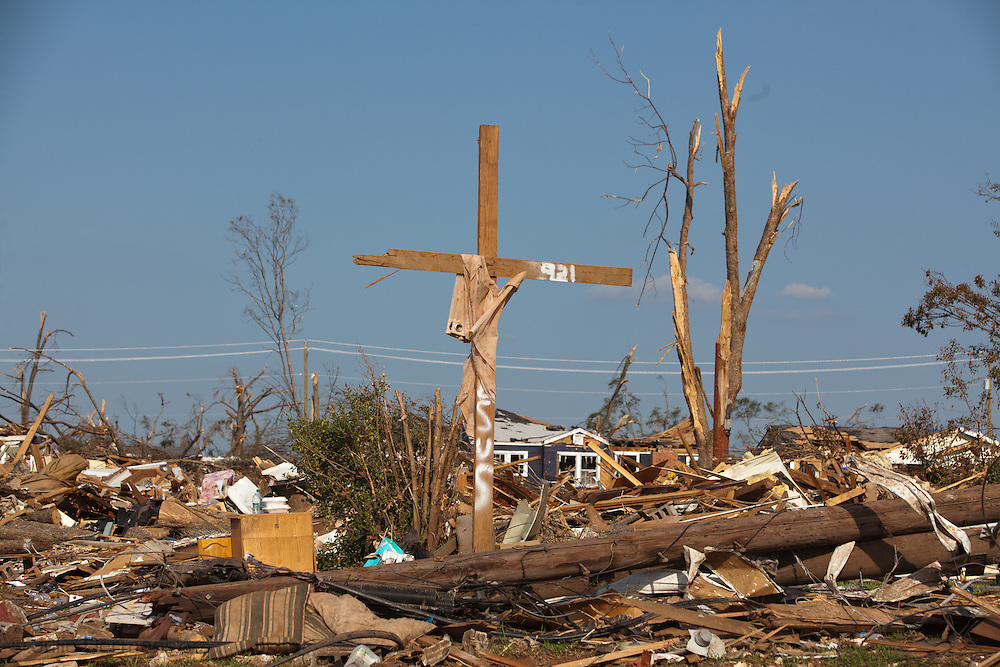 A cross stands in the middle of rubble left in a tornado's wake in  Tuscaloosa .Tuscaloosa was hit by  F-4 and  possibly  F-5 tornados that were part of a storm  of an estimated 300 that struck Alabama and the neighboring states on April 27th , 2011.