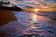 Surf on the beach at sunset on Oahu's North Shore, Hawaii