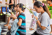 12 OCTOBER 2012 - NAKHON PATHOM, NAKHON PATHOM, THAILAND: People pray at Phra Pathom Chedi in Nakhon Pathom. The Phra Pathom Chedi in Nakhon Pathom was commissioned by King Mongkut and completed by King Chulalongkorn in 1870. The chedi is 127 meters tall and is one of the tallest pagodas in the world. It is located in the center of the city of Nakhon Pathom and has been an important Buddhist center since the 6th century. According to local history, Nakhon Pathom is where Buddhism first came to Thailand.     PHOTO BY JACK KURTZ
