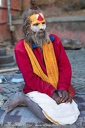Shaiva Sadhu (Hindu holy man and follower of Shiva) at Pashupatinath Temple, a sacred Hindu temple complex on the banks of the Bagmati River near Kathmandu during our Himalayan Heroes adventure, Nepal. Saturday, November 3, 2018. Photography ©2018 Michael Lichter.