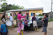 A group of children on their stilts, playing music, singing and reciting poetry in the community near the library, Biblioteca Comunitaria do Arquipelago, Porte Alegre, Brazil. <br /> <br /> Cirandar is working in partnership with  C&A and C&A Instituto to implement a network of Community Libraries in eight communities of Porto Alegre.