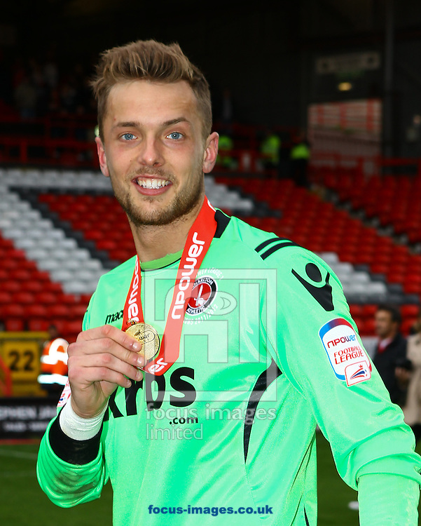 Picture by John Rainford/Focus Images Ltd. 07506 538356.05/05/12.Ben Hamer of Charlton Athletic shows his Npower League 1 winners medal at The Valley stadium, London.