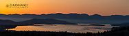 Panoramic of sunrise silhouette over Flathead Lake near Elmo, Montana, USA