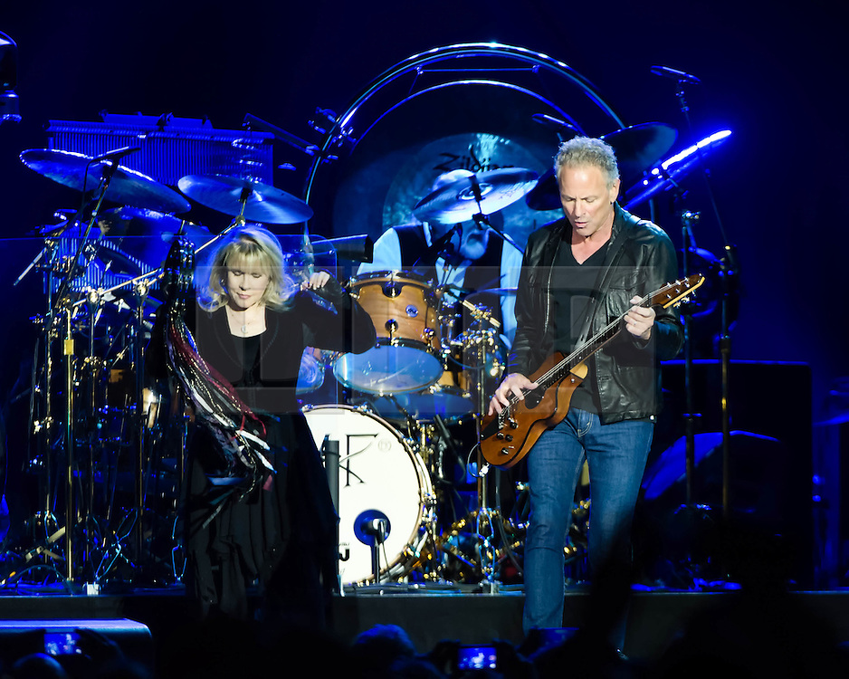 © Licensed to London News Pictures. 24/09/2013. London, UK.   Fleetwood Mac performing live at The O2 Arena.  In this pic - Stevie Nicks (left), Mick Fleetwood (centre), Lindsey Buckingham (right). Fleetwood Mac are a British-American rock band formed in 1967 in London consisting of Mick Fleetwood (drums), John McVie (bass), Lindsey Buckingham (guitar/vocals) and Stevie Nicks (vocals).  Photo credit : Richard Isaac/LNP