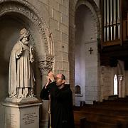 A monk rings the bells for the religious service in the abbey church of Solesmes. Solesmes on 16-10-2019<br /> Un moine sonne les cloches pour l'office religieux dans l'église abbatiale de Solesmes. Solesmes le 16-10-2019