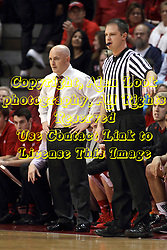 17 January 2015:   Referee Gene Grimshaw counts time standing next to Geno Ford during an NCAA MVC (Missouri Valley Conference men's basketball game between the Bradley Braves and the Illinois State Redbirds at Redbird Arena in Normal Illinois