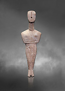 Ancient Greek Cycladic female figurine of the canonical type, Dokathismata and Spedos variety, Early Cycladic period II, Syros phase, 2800-2300 BC, Museum of Cycladic Art, Athens. Grey Background. <br /> <br /> Considered to be an intermediate or transitional form between the Dokathismata and Spedos varieties/