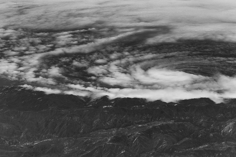 Clouds swirl around the coastline of Big Sur.