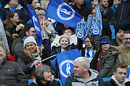football fans, football supporters with FA Cup foam fingers during the The FA Cup match between Brighton and Hove Albion and Milton Keynes Dons at the American Express Community Stadium, Brighton and Hove, England on 7 January 2017.