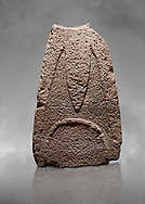 Late European Neolithic prehistoric Menhir standing stone with carvings on its face side. The representation of a stylalised male figure starts at the top with a long nose from which 2 eyebrows arch around the top of the stone. Excavated from Paule Luturru,  Samugheo. Menhir Museum, Museo della Statuaria Prehistorica in Sardegna, Museum of Prehoistoric Sardinian Statues, Palazzo Aymerich, Laconi, Sardinia, Italy .<br /> <br /> Visit our PREHISTORIC PLACES PHOTO COLLECTIONS for more photos to download or buy as prints https://funkystock.photoshelter.com/gallery-collection/Prehistoric-Neolithic-Sites-Art-Artefacts-Pictures-Photos/C0000tfxw63zrUT4