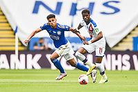 LEICESTER, ENGLAND - JULY 04: Wilfried Zaha of Crystal Palace holds up the ball from James Justin of Leicester City during the Premier League match between Leicester City and Crystal Palace at The King Power Stadium on July 4, 2020 in Leicester, United Kingdom. Football Stadiums around Europe remain empty due to the Coronavirus Pandemic as Government social distancing laws prohibit fans inside venues resulting in all fixtures being played behind closed doors. (Photo by MB Media)