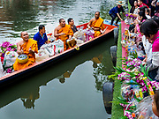 05 JANUARY 2019 - MINBURI, BANGKOK, THAILAND:  Monks pull away from the banks of Khlong Saen Saeb after collecting alms at the Kwan Riam Floating Market in Minburi, east of downtown Bangkok. People gather on both sides of the khlong (canal) between Wat Bamphen Nuea and Wat Bamphen Tai and monks in boats go past them as people present the monks with food, flowers, and other offerings. It is the only place in Bangkok where monks regularly use boats for their alms rounds.       PHOTO BY JACK KURTZ