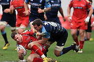 Gareth Davies of the Scarlets is tackled by Sam Warburton of the Cardiff Blues ®. Guinness Pro12 rugby match, Scarlets  v Cardiff Blues at the Parc y Scarlets in Llanelli, West Wales on Saturday 2nd April 2016.<br /> pic by  Andrew Orchard, Andrew Orchard sports photography.