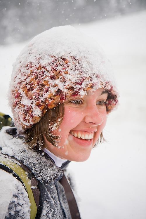 A young woman snowshoer near Snoqulamie Pass, WA.