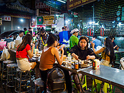 27 FEBRUARY 2019 - BANGKOK, THAILAND: People eat a restaurant on a sidewalk in Bangkok's Chinatown. Although city officials have pushed many street food venders off the streets of Bangkok, those officials have allowed Chinatown's venders to remain. Bangkok, a city of about 14 million, is famous for its raucous nightlife. But Bangkok's real nightlife is seen in its markets and street stalls, many of which are open through the night.        PHOTO BY JACK KURTZ