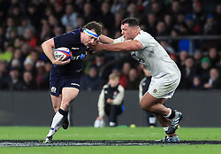 Scotland's Hamish Watson (left) in action with England's Ellis Genge during the Guinness Six Nations match at Twickenham Stadium, London.