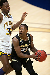 Feb 13, 2021; Berkeley, California, USA; Colorado Buffaloes guard McKinley Wright IV (25) looks for a route to the basket past California Golden Bears guard Jalen Celestine (32) during the second half of an NCAA basketball game at Haas Pavilion. Mandatory Credit: D. Ross Cameron-USA TODAY Sports