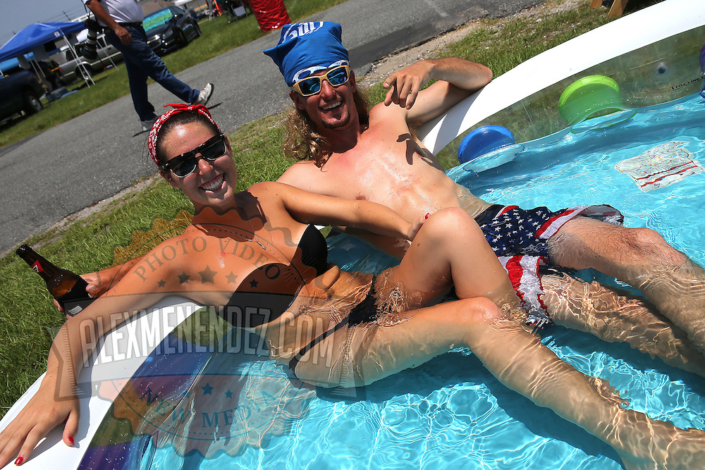Alyssa Hodgson and Brandon Ray from Ocala, Florida relax in their pool prior to the 57th Annual NASCAR Coke Zero 400 stock car race at Daytona International Speedway on Sunday, July 5, 2015 in Daytona Beach, Florida.  (AP Photo/Alex Menendez)
