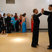 "Same-sex ballroom dancers Soren (umlaut on the ""o""), far right,  and Bradley Stauffer-Kruse warm up for the men's standard competition while the women's latin competitors line up to compete at the 5 Boro Dance Challenge on May 5, 2007...The locally produced 5 Boro Dance Challenge, New York City's first major same-sex dance competition, was held at the Park Central Hotel in Manhattan from May 4-6, 2007. ."