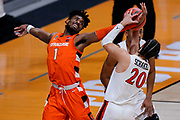 Syracuse forward Quincy Guerrier (1) fights for a rebound with San Diego State guard Jordan Schakel (20) in the first half of a college basketball game in the first round of the NCAA tournament at Hinkle Fieldhouse in Indianapolis, Friday, March 19, 2021. (AP Photo/AJ Mast)